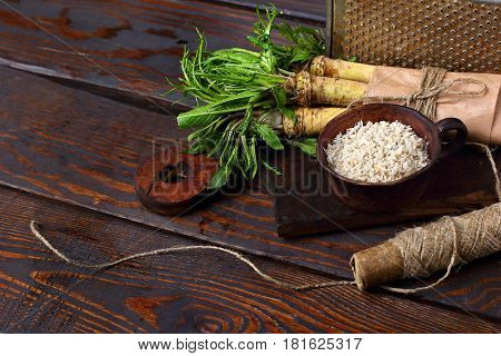 Raw Horseradish Roots On Wooden Background. Horseradish With Leaves.homemade Wassabi.copy Space