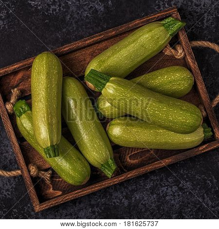 Fresh Healthy Green Zucchini Courgettes In Brown Wooden Box.