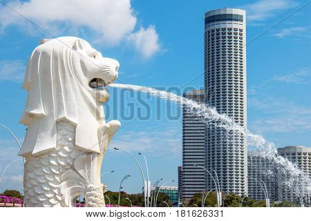 SINGAPORE-MAR 21: Unidentified tourist group visit Singapore landmark Merlion view with Marina Bay Sands Hotel dominates at Marina Bay Sands in the afternoon in Singapore 21 March 2017.