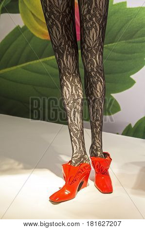 PARIS FRANCE - MARCH 27 2017: Details of the shop window decoration in the Printemps department store in Paris France. Lace pantyhose on a mannequin