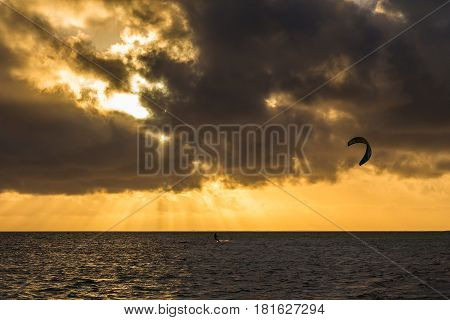 Silhouette of a kite surfer enjoying an empty stretch of coastline one morning in Cuba. The area of Cayo Guillermo has grown in popularity as a kite surfing destination in recent years thanks to the combination of the shallow waters & constant brisk winds