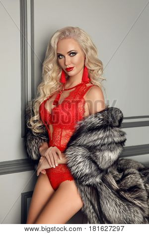 Fashionable Blond Woman In Luxury Fur Coat Wears In Sexy Red Lace Lingerie. Fashion Underwear. Beaut