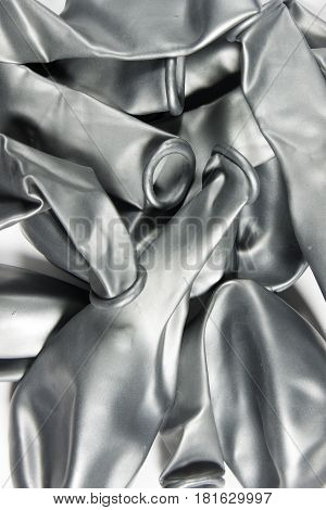 This is a photograph of deflated Silver Metallic Helium Balloons