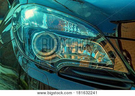 Closeup photograph of headlights of moderm new car.