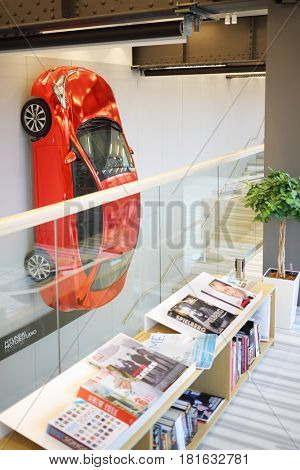 MOSCOW - APR 16, 2016: Hyundai Solaris on wall and magazines in Hyundai Motorstudio. Hyundai produces not only cars, but also its own collection of furniture and household items