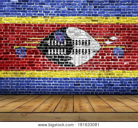Swaziland flag painted on brick wall with wooden floor