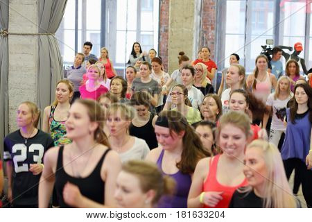 MOSCOW - APR, 16, 2016: Women jogging on fitness dance in DI Telegraph. Everyone will be able to exercise free of charge at Reebok sites in Moscow park
