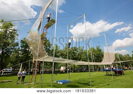 MOSCOW - MAY 26, 2016: Acrobats show on Trapeze. In Moscow, opened first in Russia trapeze for Air flight school and aerial gymnastics Trapeze Yota - school and show