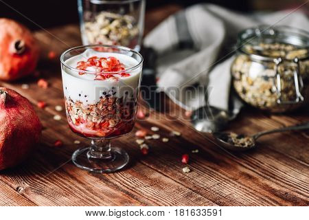 Pomegranate Parfait with Ingredients on Backdrop. Series on Prepare Healthy Dessert with Pomegranate Granola Cream and Jam.