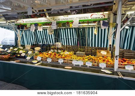 Munich Bavaria Germany.- March 28 2017. Fruit stand in the German street market in St Anna platz next to the church of
