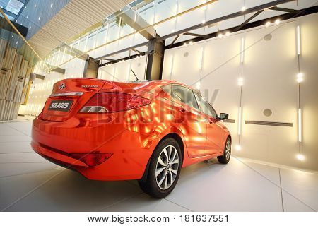 MOSCOW - APR 16, 2016: Red Hyundai Solaris model are on wall in Hyundai Motorstudio. Hyundai produces not only cars, but also its own collection of furniture and household items