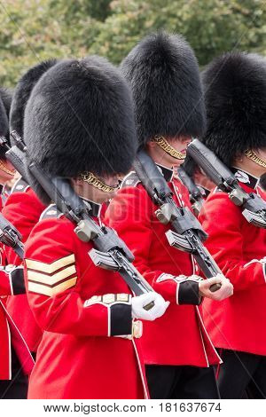 LONDON - JUL 1 2015: British Royal guards performing the Changing of the Guard at Buckingham Palace. The ceremony is one of the top attractions in London and UK military traditions.