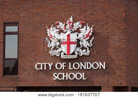 LONDON UK - JUL 1 2015: City of London school sign on a red brick wall in London. CLS is a day school for boys.