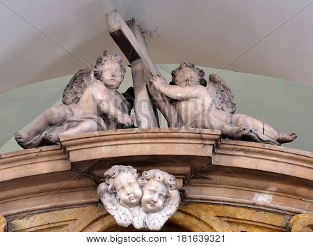 DUBROVNIK, CROATIA - NOVEMBER 08: Angels on the altar in Franciscan church of the Friars Minor in Dubrovnik, Croatia on November 08, 2016.