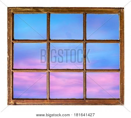 colorful sunset sky as seen  through vintage, grunge, sash window with dirty glass