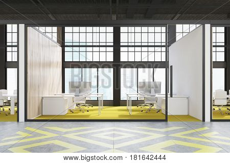 Office cubicle with a bright yellow floor white tables and computers on them in a loft. 3d rendering.