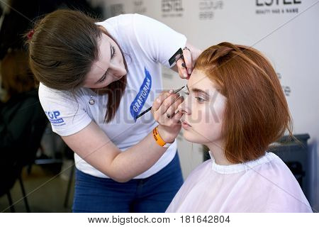 Kyiv, Ukraine - February 7, 2017: Makeup Artist At Work. Backstage Of Ukrainian Fashion Week 2017