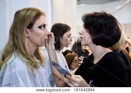 Kyiv, Ukraine - February 7, 2017: Makeup Artist At Work. Backstage Of Ukrainian Fashion Week 2017