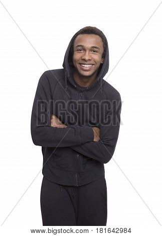Isolated portrait of a positive African American young man with a broad smile wearing a black hoodie.