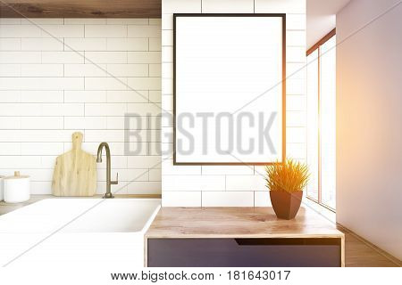 Close up of a kitchen sink and a wooden countertop with a flower pot standing on it. There is a framed vertical poster above it. 3d rendering mock up toned image