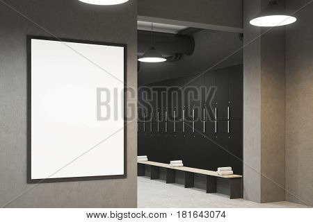 Side view of a gray locker room with benches along the rows of lockers. There is a vertical framed poster on a wall. 3d rendering mock up