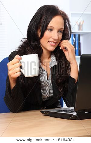 Beautiful Business Woman Has Coffee At Work