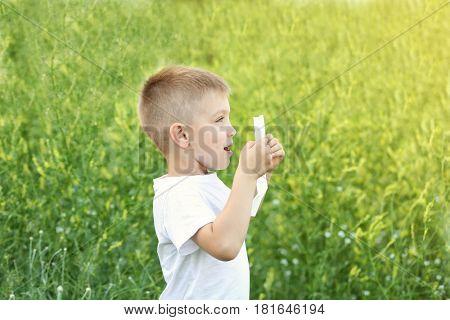Seasonal allergy. Little boy with tissue outdoor