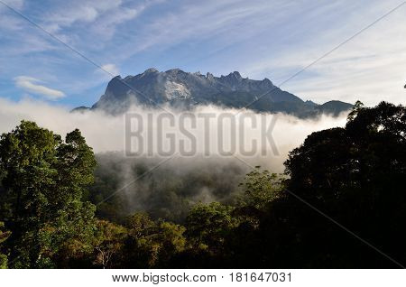 Beautiful view of Mount Kinabalu with fogs and clouds surrounding the mountain Sabah Borneo Malaysia.