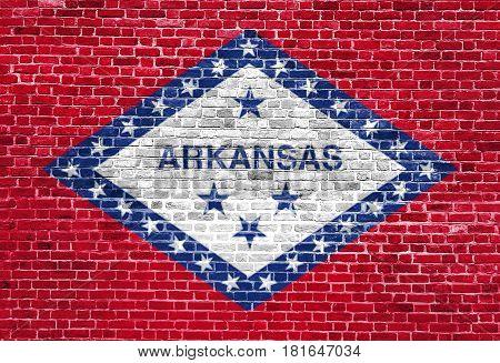 Arkansas US flag painted on old vintage brick wall