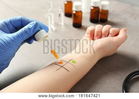 Patient making allergy test in laboratory