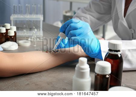 Doctor making allergy test in laboratory