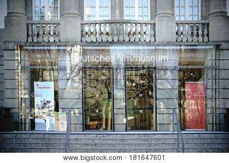 FRANKFURT, GERMANY - JANUARY 05: The large glass entrance of the German Filmmuseum with posters and advertising on January 05, 2017 in Frankfurt.