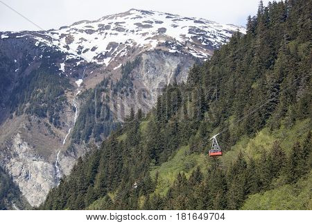 The view of a cable car with Juneau Mountain is a background (Juneau Alaska).