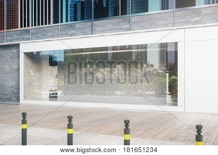 Side view of empty glass storefront in daylight. Advertisement concept. Mock up 3D Rendering