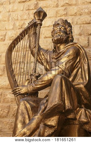 Golden statue of King David with his famous harp, Jerusalem, Israel