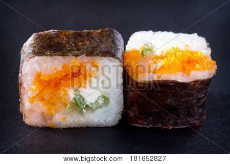 Roll Okinawa Isolate On A Black Slate Board - Tobiko Orange Caviar, Shrimp, Soft Cheese, Cucumber, N