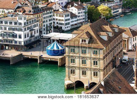 Zurich, Switzerland - September 2, 2016: Old Town Hall and carousel at River Limmat in Zurich Switzerland