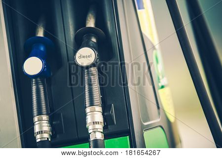 Gas Station Fuel Dispenser Closeup Photo. Car Refueling Concept Photo.