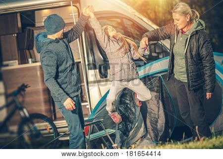 Modern Happy Family Camping. Motorcoach RV Camper Camping. Happy Family with Child.