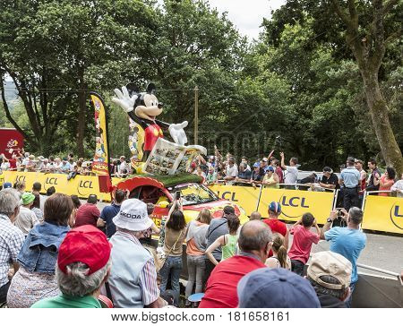 Plumelec France - 12 July 2015: Mickey's car during the passing of the Publicity Caravan before the Team Time Trial stage between Plumelec and Vannes during Tour de France on 12 July 2015.