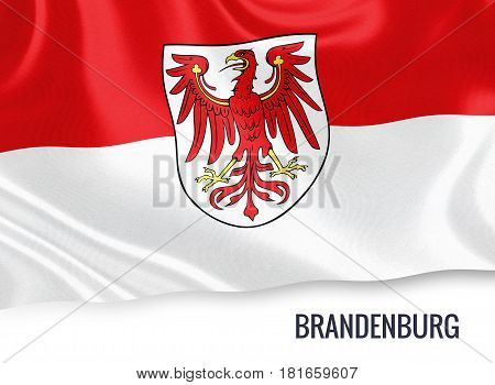 German state Brandenbourg flag waving on an isolated white background. State name is included below the flag. 3D rendering.