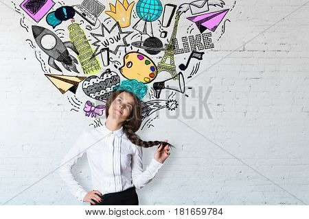 Daydreaming young woman on white brick background with sketch. Social media concept