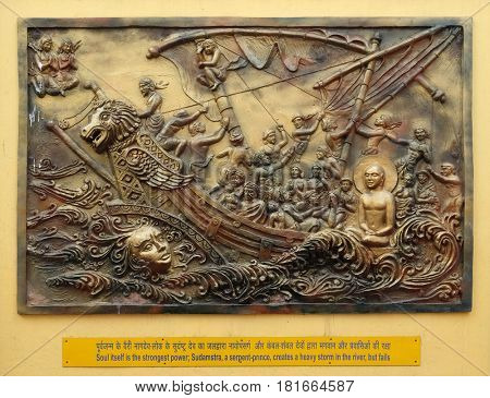 KOLKATA,INDIA - FEBRUARY 09, 2016: Soul itself is the strongest power; Sudamstra, a serpent-prince, creates a heavy storm in the river, but fails, bass relief on the wall of Jain Temple in Kolkata