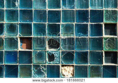 Old wall from the glass block. Broken broken glass wall