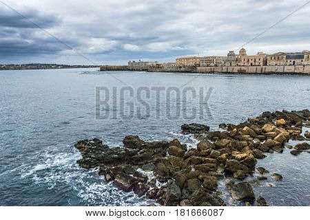 Aerial view on sea shore of Ortygia isle Syracuse city Sicily Island in Italy