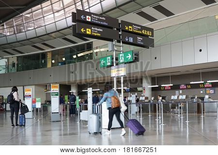 VALENCIA, SPAIN - APRIL 14, 2017: Airline passengers inside the Valencia Airport. About 4.59 million passengers passed through the airport in 2016.