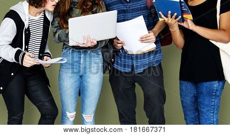 Group of Diverse High School Students Using Digital Devices Studio Portrait