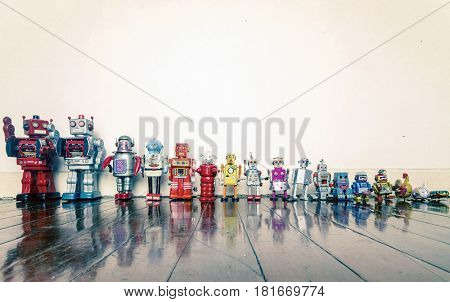 a line of vintage robots from small to big