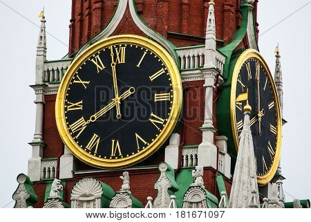 Russia. Moscow. Kremlin Clock is a historic clock on the Spasskaya Tower of the Moscow Kremlin. The clock dial is above the main gates to Red Square. The Kremlin clock faces have a diameter of 6.12 metres (20.1 ft) and are placed on all four sides of the