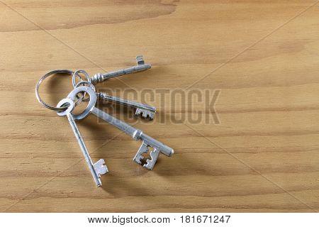 Bunch of Skeleton Keys on Wooden Background